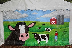 CONNECTION PHOTO: KELSEY O'HALLORAN - Wilson High School art students designed and painted this tent panel mural to decorate Hillsdale Food Cart Park and highlight the dairy farms of the area's past.