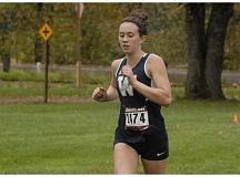 SUBMITTED PHOTO: MATT RAWLINGS - Wilsonville runner Brooklyn Stenstrom won the varsity girls Northwest Oregon Conference title at Blue Lake Park Wednesday, Oct. 26.