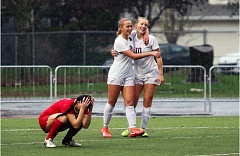 DAN BROOD - Sherwood seniors Lindsay Howard (10) and Kailen Fried smile following Howard's third goal of the match in the Lady Bowmen's 6-0 win over Oregon City in Saturday's state playoff quarterfinal contest.