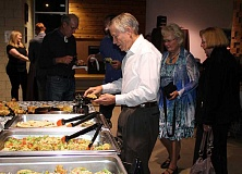 HOLLY M. GILL - Bud Beamer fills a plate at the annual MAC Bash fundraiser for the MAC Trust. More than 50 supporters of the Madras Aquatic Center attended the event, held Friday, Nov. 4, at the MAC.