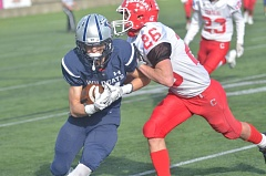 SPOKESMAN PHOTO: COREY BUCHANAN - Wilsonville running back Trevor Antonson scampers toward the sideline on a pass play.