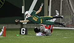 TIDINGS PHOTO: MILES VANCE - West Linn's Jake Meisen, who scored two touchdowns in his team's 41-20 win over Clackamas in the Class 6A state semifinals at Providence Park, tries for a third on Friday.