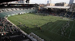TIDINGS PHOTO: MILES VANCE - The West Linn (right) and Central Catholic football teams prepare for today's Class 6A state championship football game at Providence Park.
