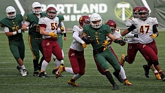 TIDINGS PHOTO: MILES VANCE - West Linn senior running back Elijah Molden battles for yardage during his team's 62-7 win over Central Catholic in the Class 6A state championship game at Providence Park.