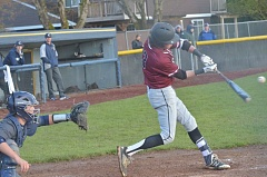 HERALD PHOTO: COREY BUCHANAN - Sherwood batter Andrew Edmunds crushes the baseball to the outfield against Canby.