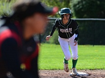 OUTLOOK PHOTO: DAVID BALL - Reynolds Raven Laine makes her move off second base during the Raiders' 5-1 win at David Douglas to start the league season Saturday.