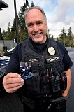 TIDINGS PHOTO: VERN UYETAKE - West Linn Police Officer Jeff Mayer says he hopes a new Cop Card program will foster strong relationships between kids and police.