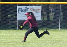 TRIBUNE PHOTO: JONATHAN HOUSE - Franklin High's Alicia Peraza, a freshman outfielder, snags a line drive against Roosevelt on Tuesday at Erv Lind Stadium. The Quakers won their fifth game in a row, defeating the Roughriders 2-1 in a battle for first place in the Portland Interscholastic League.