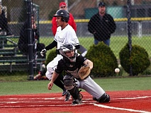 DAN BROOD - Tigard junior Jaron West crosses home plate as Tualatin catcher Cole Kinman reaches for the ball during Friday's game.