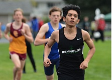 OUTLOOK PHOTO: DAVID BALL - Reynolds Andy Solano led start-to-finish in the 1,500-meter race during Wednesdays home three-way meet.