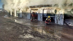 PHOTO COURTESY OF CROOK COUNTY FIRE AND RESCUE - Firefighters work to extinguish a storage facility fire Friday morning.