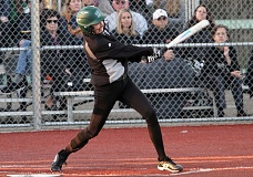 TIDINGS PHOTO: MILES VANCE - West Linn's Kaitlin Lampson hits an inside-the-park home run during her team's 12-2 win in five innings over Sherwood at Rosemont Rudge Middle School on Thursday.