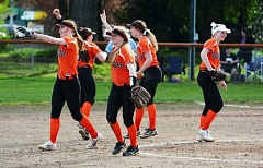 SPOTLIGHT PHOTO: JAKE MCNEAL - Indians sophomore Sara Mills, center, and the Indians infield celebrate an out against Banks on Friday in Scappoose.
