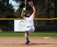 REVIEW PHOTO: MILES VANCE - Lakeridge pitcher Rachel Mindt cranks it up during the first inning of her team's 11-1, five-inning win over rival Lake Oswego at Lakeridge High School on Friday.