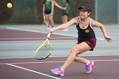 NEWS-TIMES PHOTO: CHRISTOPHER OERTELL - Forest Grove's Esther Vega hits a volley near the net during a match against McKay.