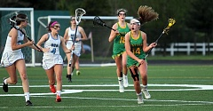 TIDINGS PHOTO: MILES VANCE - West Linn's Emma Deering (right) races upfield during her team's 12-9 loss at Oregon Episcopal School on Friday evening.