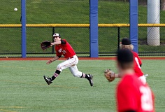 TRIBUNE PHOTO: JONATHAN HOUSE - Nick Ostmo of Lincoln High chases down a line drive against Madison. The Cardinals are unscathed in eight PIL games.