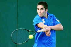 SETH GORDON - Senior Israel Pintor hits a ground stroke during his No. 3 singles match versus Tigard April 18. Pintor fell in three sets, but Newberg won the match 6-2.