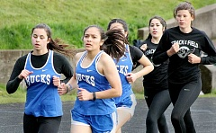 SETH GORDON - Taysha Veeman (left) and Griselda Vargas-Ayala lead a pack of runners during St. Paul's Tri-River Conference meet versus Regis April 27 at Colton High School.