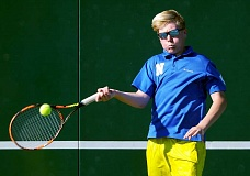 SETH GORDON - Quinton Nigbur smashes a forehand during Newberg's home loss to West Linn May 3. It was the Tigers' first dual meet loss of the season.