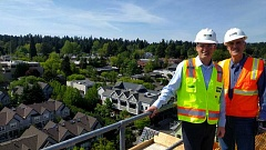 REVIEW PHOTO: ANTHONY MACUK - Mayor Kent Studebaker (right) and several city councilors joined developer Patrick Kessi (left) and other dignitaries Tuesday for a climb to the top of the 171-foot-tall crane that towers over the Wizer Block in downtown Lake Oswego.