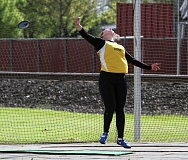 TIDINGS PHOTO: MILES VANCE - West Linn's Meghan Carbenier releases a throw in the girls discus competition during the Three Rivers League district track meet at Linfield College in Friday.