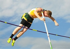 PMG PHOTO: SETH GORDON - West Linn's Justin Gould soars to victory in the pole vault on May 10 during the Three Rivers League district track meet at Linfield College.