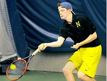 SETH GORDON - Ben O'Laughlin reaches for a shot during his consolation match versus Tualatin's Daniel Loeffler Friday at the Three Rivers League District Championships at the Portland Tennis Center.