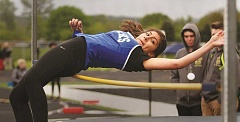 SETH GORDON - Stephanie Morales clears the bar Thursday en route to a fourth place in the high jump at the Tri-River Conference District Championships in Scio. The Bucks placed fourth as a team.
