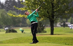 TIDINGS PHOTO: MILES VANCE - West Linn senior Blake Westover tees off during Tuesday action at the Class 6A boys state golf tournament at Quail Valley Golf Course in Banks.