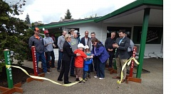 SUBMITTED PHOTO - First Tee of Greater Portland's leaders, along with Gladstone and local business leaders, help cut the ribbon on the newly renovated building.