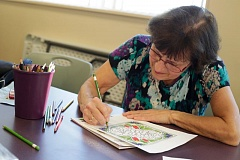 TIMES PHOTO: JONATHAN HOUSE - Laura Dickinson colors in coloring books at the Cedar Mill Community Library.