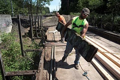 COURTESY OF THPRD - Workers for Benchmark Contracting, a THPRD contractor, prepare for structural upgrades to an old railroad trestle that will be part of the connection between the Westside Regional Trail and Waterhouse Trail.