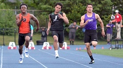 TIMES PHOTO: MATT SINGLEDECKER - Beaverton junior Anthony Albright (left) blew past the 100-meter dash field to take first place at the Metro League district championship at Aloha High School on Friday.