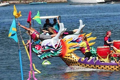 PAMPLIN MEDIA GROUP FILE PHOTO - The Rose Festival brings out many citizens for the Dragon Boat Races. Says Tom Crowder, longtime organizer: 'We're slowly building it back up.' Sixty-five teams are expecte4d to compete this weekend.