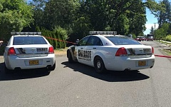 SUBMITTED PHOTO - Washington County Sheriff's deputies blocked off a section of Southwest Blanton Road east of 170th Avenue on Monday while investigators processed the scene of a fatal shooting that morning.