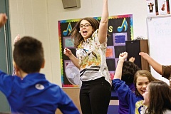 TIMES FILE PHOTO - Kim Putnam, a music teacher at Hazeldale Elementary School - here dancing with third-graders - and her fellow teachers will likely see longer school years beginning next year.