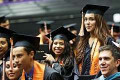 TIMES PHOTO: JAIME VALDEZ - Kimberly Garcia, left, and Amanda Garcia react after receiving their diplomas during Beaverton High School's graduation at the Chiles Center.