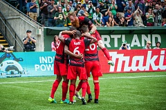 TRIBUNE PHOTO: DIEGO G. DIAZ - The Portland Timbers celebrate the first of their three goals Sunday at home against Seattle.