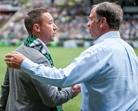 TRIBUNE PHOTO: DIEGO G. DIAZ - Coaches Caleb Porter (left) of Portland and Bruce Arena of Los Angeles shake hands at Saturday's match.