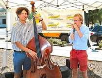 DAVID F. ASHTON - Entertaining as the duo Thorleif & Colescott, Sellwood resident Colescott Rubin, left, and Icelandic music student Thorleif Davidsson perform at the Lents International Farmers Market.