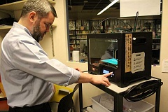 TIDINGS PHOTOS: PATRICK MALEE - Library Manager Rick Peterson demonstrates how to use the 3-D printer.