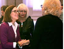 TRIBUNE PHOTO: JAIME VALDEZ - Gov. Kate Brown greeted people at Wednesday's Portland Business Alliance meeting. Brown told the group that her decision to endorse the corporate tax measure was extremely difficult for her.