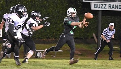 ESTACADA NEWS: HEATHER TREANOR - Rangers QB Andy Avants makes a pitch to the outside while being chased by a bunch of Outlaws in last weeks playoff win.