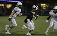 PAMPLIN MEDIA GROUP: WADE EVANSON - Sherwood High School sophomore Ben Baxter heads up field during the Bowmen's state playoff win over Century on Friday.