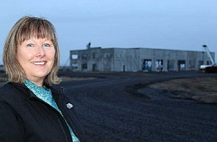 HOLLY M. GILL - Janet Brown, Jefferson County manager for Economic Development of Central Oregon, has assisted Daimler Trucks North America in its efforts to move its testing facility to the Madras Industrial Site. The $18.7 million facility will include a test track and office facility (in the background). Brown successfully nominated Daimler for an economic development excellence award, which the company received late last month from the Oregon Economic Development Association.