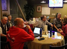 HOLLY M. GILL - On election night, at Geno's, Bill and Helen Houts (from left), Rick Allen, Mike Solso, Joe Krenowicz and Kelly Kingsbury watch as election results roll in.