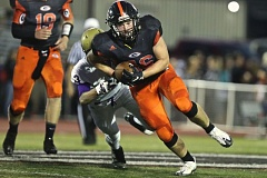 PAMPLIN MEDIA: JAIME VALDEZ - Gladstone's Quinn Carl finished the season with 186 carries for 1,566 yards and 21 rushing touchdowns for the 6-4 Gladiators.