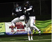 DAN BROOD - Tigard seniors Jared Stewart (42) and Aksel Thorsfeldt, and the rest of the Tigers, will face Sheldon in a Class 6A state playoff quarterfinal game on Friday.