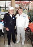 BARBARA SHERMAN - At the Tigard High School breakfast before the veterans' assembly, two World War II Navy veterans met for the first time: Carl Finley of Tigard (left, wearing his uniform), and Joe Doyon of Summerfield.